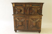 An eighteenth century oak cabinet, with double lower doors enclosing three drawers, width 119 cm.