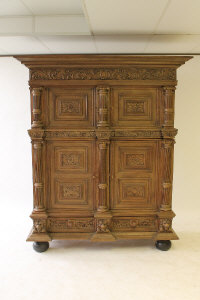 A continental carved oak four door cabinet, fitted with two drawers, width 170 cm.