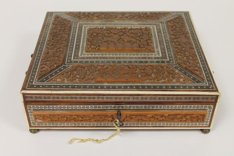 A late 19th century Indian carved wood and ivory inlaid casket