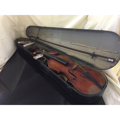 A violin and bow in wooden coffin case bearing paper label Paganini