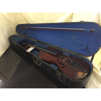 A violin and bow in wooden coffin case bearing paper label Norman Hunter, The Studio, Port Glasgow, dated 1902.