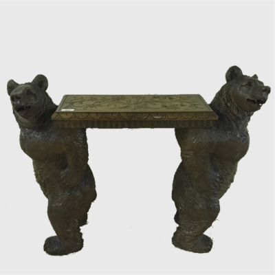 A Black Forest carved seat, supported by two bears, height 62 cm.
