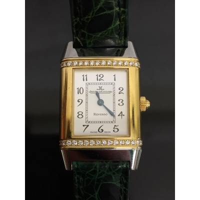 A Jaeger-Le-Coultre Reverso wrist watch in two-tone gold encrusted with diamonds, numbered 1879662, with original retail box and paperwork.