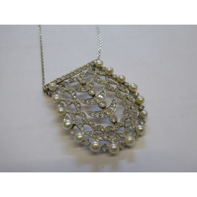 A fine pearl and diamond pendant on platinum chain
