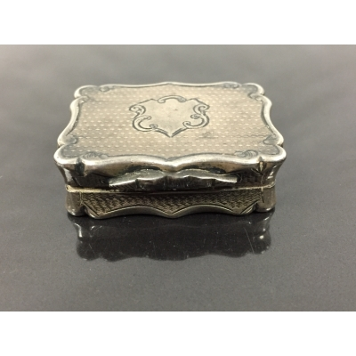 A Victorian silver vinaigrette, Birmingham 1861, with gilt and engraved interior