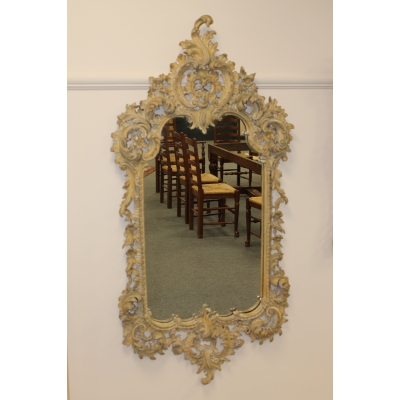 An Ornately Carved Wall Mirror